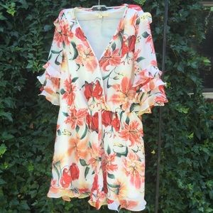 Entro Ruffle Sleeves Flower Print Romper Shorts.